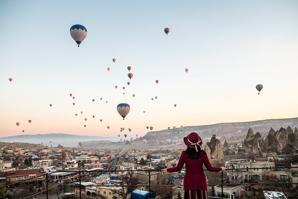 Woman Watching Hot Air Balloons in Cappadocia